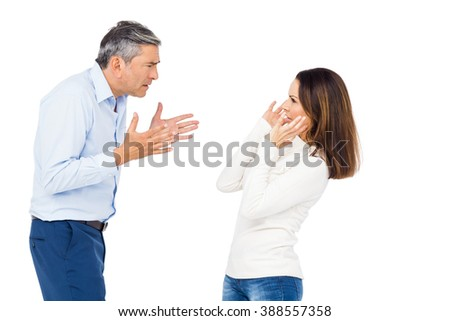 Annoyed man yelling at wife against white background - stock photo