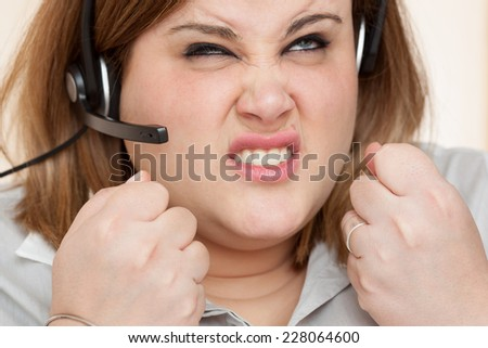 Annoyed receptionist closeup portrait. - stock photo