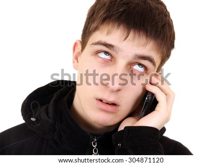 Annoyed Teenager with Cellphone Isolated on the White Background