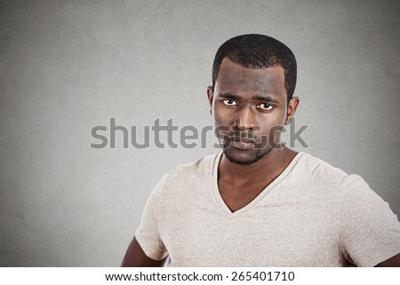 Annoyed unhappy young man looking at you camera  - stock photo