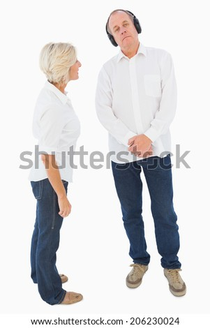Annoyed woman being ignored by her partner on white background - stock photo
