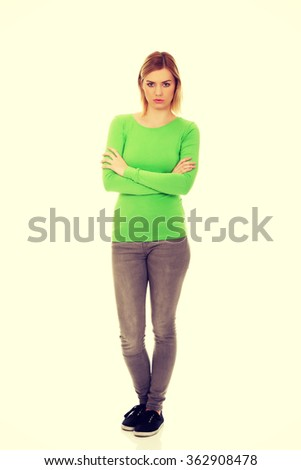 Annoyed woman with arms crossed. - stock photo