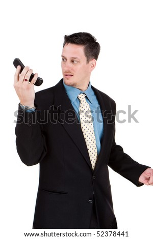 Annoyed young suit talking on the telephone