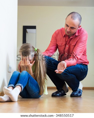 Annoying dad giving instructions to unhappy frustrated female child
