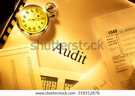 Annual budget, calendar, stopwatch and audit - stock photo