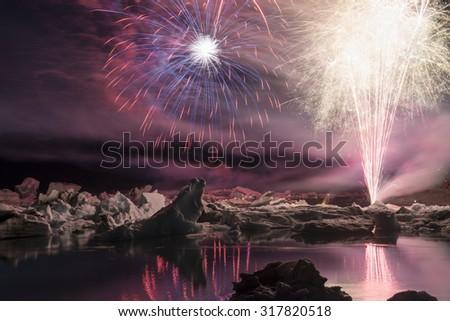 Annual firework show among icebergs at Ice lagoon Jokulsarlon, Iceland - stock photo