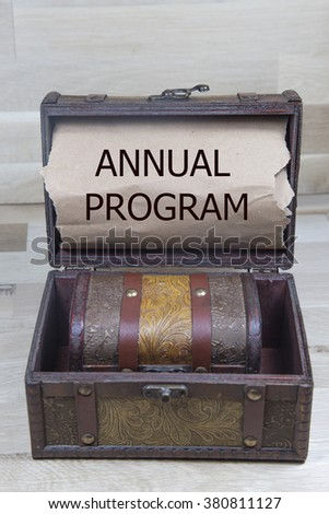 annual program is written on the Brown torn paper in the treusary box