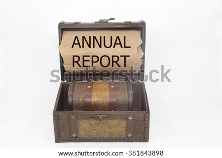 annual report is written on the Brown torn paper in the treasure box. isolated on white background