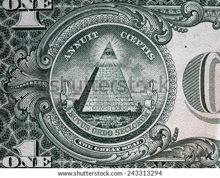 Annuit coeptis motto and the Eye of Providence on the reverse side of one American dollar bill. USD - stock photo