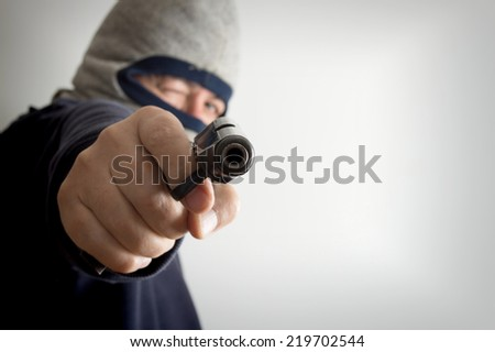anonymous armed robbery - stock photo