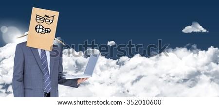 Anonymous businessman against night sky - stock photo