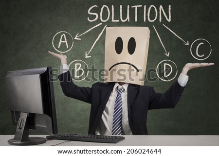 Anonymous businessman doubt to choose the solution - stock photo
