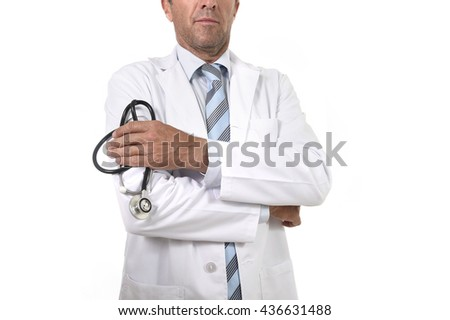 anonymous crop face male medicine doctor holding stethoscope in his hand wearing medical gown standing proud in corporate portrait isolated on white background - stock photo