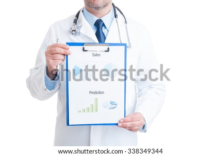Anonymous doctor showing medical charts isolated on white background. Medicine sales and financial prediction graphs concept