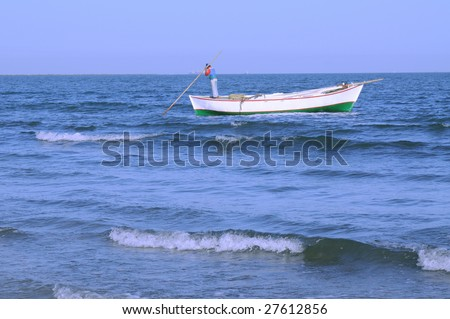anonymous fisherman in his boat in the mediterranean sea in egypt