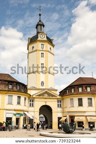 ANSBACH, GERMANY - AUGUST 22: Tourists at the Herrieder Tor in Ansbach, Germany on August 22, 2017. The city gate is one of the most important historic buildings of Ansbach.