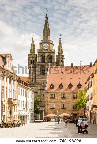 ANSBACH, GERMANY - AUGUST 22: Tourists at the St. Gumbertus church in Ansbach, Germany on August 22, 2017. The church is considered Ansbach's city symbol.