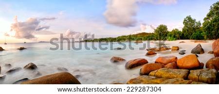 Anse Lazio beach panorama at sunset, Praslin, Seyshelles - stock photo