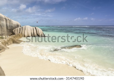 Anse Source d'Argent beach, La Digue Island, Seychelles. Boulders black granite rocks, turquoise water, white sand and blue sky. - stock photo