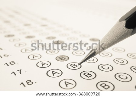 Answer sheet and pencil for education concept - stock photo