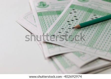 answer sheet, test score sheet with answers in thai education - stock photo