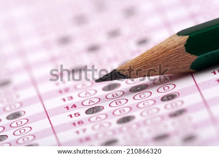 Answer sheet with pencil - stock photo