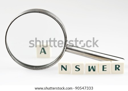 Answer word and magnifying glass - stock photo