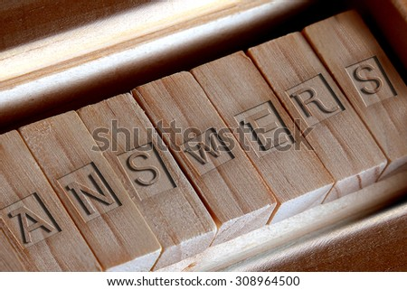 ANSWERS word carved on the wood - stock photo