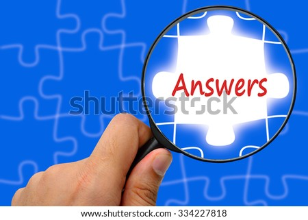 Answers word. Magnifier and puzzles. - stock photo