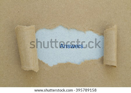 Answers written under torn paper. - stock photo