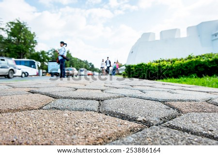 Ant eye view, Pavement in front of Grand palace fortress. - stock photo