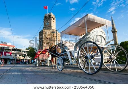 Antalya city center and phaeton against clock tower  - stock photo