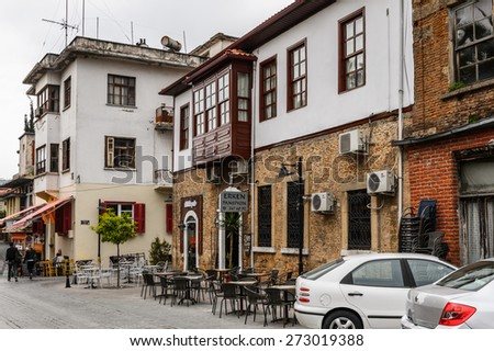 ANTALYA, TURKEY - APR 19, 2015: Hotels and shops in the Historic part of Antalya (Kaleici), Turkey. Old town of Antalya is a popular destination among  tourists