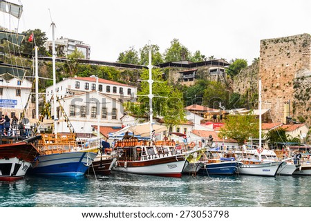 ANTALYA, TURKEY - APR 19, 2015: Touristic decorated ship in the Old harbour in Antalya (Kaleici), Turkey. Old town of Antalya is a popular destination among  tourists