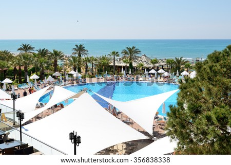 ANTALYA, TURKEY - APRIL 20: The tourists enjoing their vacation in luxury hotel on April 20, 2014 in Antalya, Turkey. More then 36 mln tourists have visited Turkey in year 2014 - stock photo