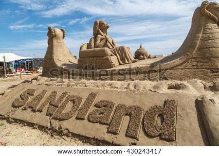ANTALYA, TURKEY - APRIL 23, 2016 : View of big sand sculptures made in Lara Beach, Antalya for sandland project, on cloudy blue sky background.