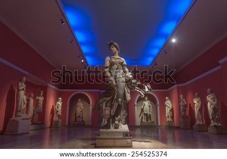 ANTALYA, TURKEY - FEBRUARY 21, 2015: The statue of a dancing woman, dated 200 AD, at Antalya Archeological Museum,  found at the ancient city of Perge, together with other statues found at Perge. - stock photo