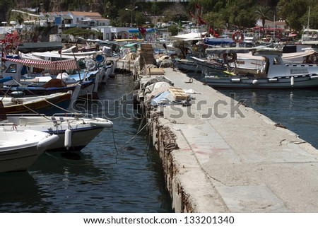 ANTALYA, TURKEY - JULY 26: Harbor of the town Antalya in Turkey on July 26, 2009. Antalya is the world's third most visited city by number of international arrivals in 2011 - stock photo