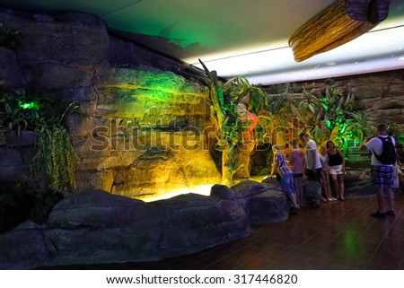ANTALYA, TURKEY - JULY 28, 2015: People in the Antalya aquarium. The aquarium is the longest in the world panoramic tunnel with a length of 131 meters