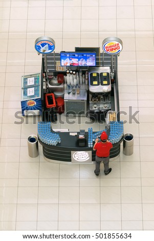 Antalya, Turkey, May 8, 2016: Fast food in the mall on the background of the white tiled floor, top view