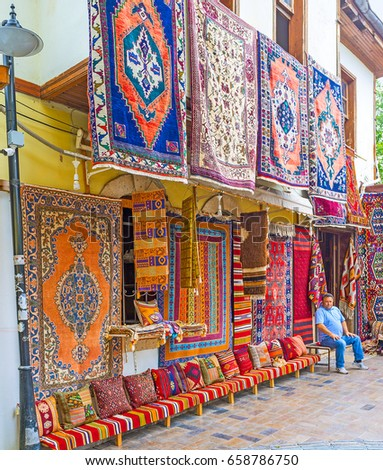 ANTALYA, TURKEY - MAY 6, 2017: Kaleici boasts numerous carpet stores, these goods are popular in Turkey and among the foreign tourists, often choosing kilim rugs or carpets here, on May 6 in Antalya.
