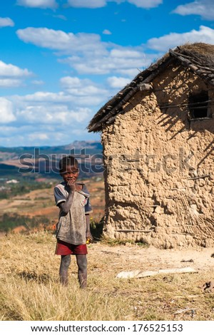ANTANANARIVO, MADAGASCAR - JUNE 30, 2011: Unidentified Madagascar girl stays near the old house.  People in Madagascar suffer of poverty due to slow development of the country
