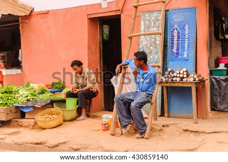 ANTANANARIVO, MADAGASCAR - JUNE 29, 2011: Unidentified Madagascar man and woman work at the market. People in Madagascar suffer of poverty due to the slow development of the country - stock photo