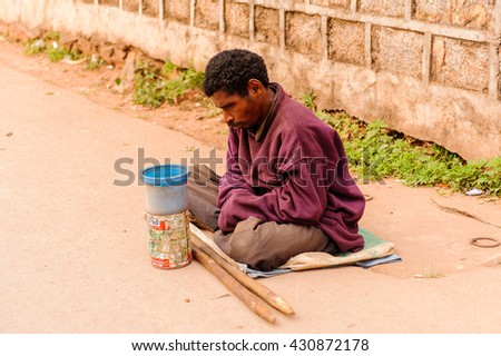 ANTANANARIVO, MADAGASCAR - JUNE 30, 2011: Unidentified Madagascar misary man in the street. People in Madagascar suffer of poverty due to the slow development of the country - stock photo