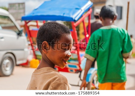 ANTANANARIVO, MADAGASCAR - JUNE 30, 2011: Unidentified Madagascarboy smiles in the street. People in Madagascar suffer of poverty due to the slow development of the country