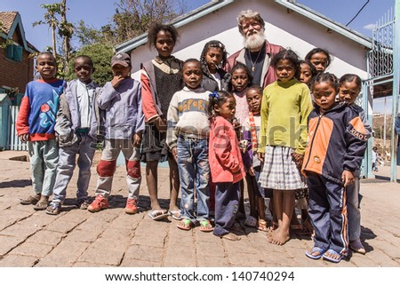 ANTANANARIVO, MADAGASCAR, SEPT 06: Father Pedro Opeka with children in his village of Akamasoa, Antananarivo, Madagascar on september 06, 2007. Father Pedro is nominated for Nobel Peace Prize 2013. - stock photo