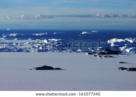 Antarctic from the airplane. Bird's eye view of the icebergs