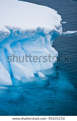 Antarctic glacier in the snow. Beautiful winter background. - stock photo