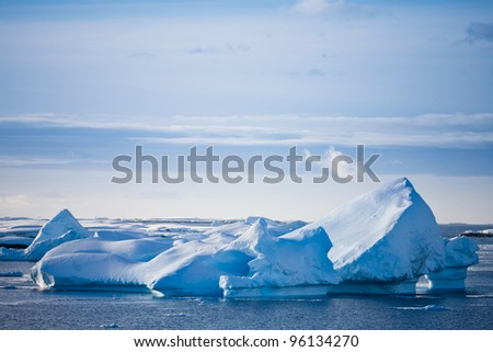 Antarctic glacier in the snow. Beautiful winter background - stock photo