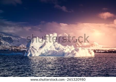 Antarctic Glacier with cavities. Beautiful winter background. Antarctica. Research Base. - stock photo
